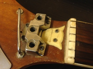 Sting guides, truss rod cover and nut